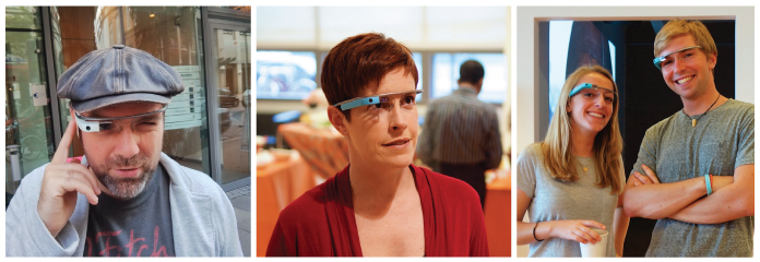 Three photographs of different people wearing Google Glass. From left to right: 1) A man with a beard wearing a black leather cap, light grey cardigan and dark grey T-shirt; he is standing on a street and holding the index finger of his right hand to a white Google Glass. 2) A woman with short, reddish brown hair, wearing a red dress and standing in an office environment; she is wearing a blue Google Glass. 3) A young man and woman, both with blond hair and wearing grey T-shirts. He has his arms folded and she is holding a cup of coffee.  Both are wearing blue Google Glass'.