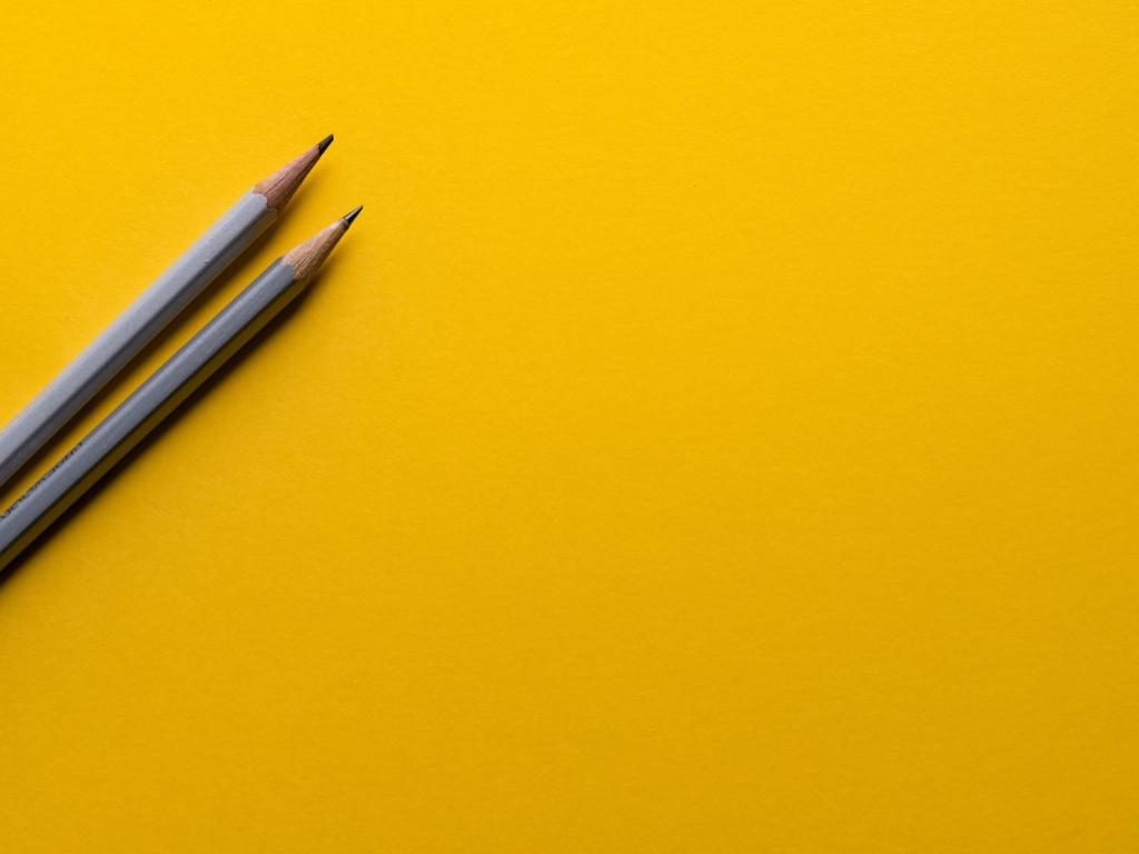 Two pencils on a yellow background - getting ready for marketing planning